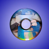 Dvd or cd and old floppy disk inside Stock Photos