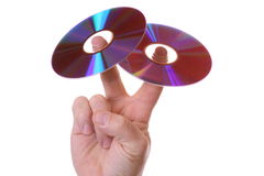 Dvd Cd Peace sign. DVD CD-rom on a human hand on top of two fingers doing the peace sign Royalty Free Stock Images
