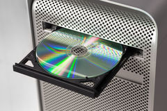 DVD CD ROM on a computer opened to show disc. Top view Stock Images