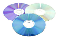 Dvd and cd-s. One dvd and two cd-s over white Royalty Free Stock Photography
