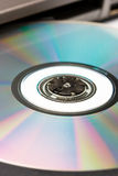 Dvd cd technology. Cd or dvd disk in the drive of a laptop Stock Photo