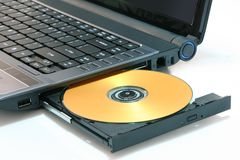 DVD on computer Royalty Free Stock Image