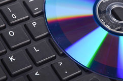 DVD and computer keyboard Royalty Free Stock Image