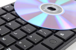 DVD and computer keyboard Royalty Free Stock Photos