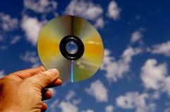 DVD contre le ciel images stock