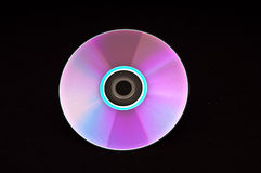 DVD Disc. Single DVD on black background Royalty Free Stock Image