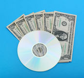 DVD disc with dollar notes Royalty Free Stock Image