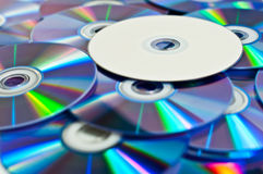 DVD Discs. Many disks and lies on top of them is white dvd drive Royalty Free Stock Photography