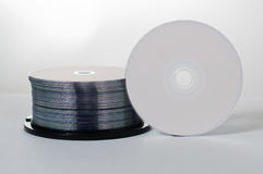 DVD Discs. Many disks and lies on top of them is white dvd drive Stock Images