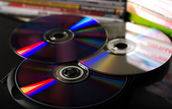 DVD discs. Optical CD and DVD discs with music and movies in plastic case Stock Images