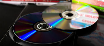 DVD discs. Optical CD and DVD discs with music and movies in plastic case Stock Image