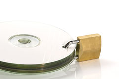 DVD discs and padlock Stock Photos