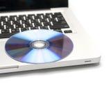 Dvd dish on laptop Stock Image