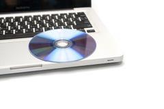 Dvd dish on laptop Stock Photography