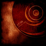 DVD disk. With old paper background Royalty Free Stock Image