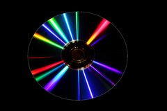 DVD disk with colorful pattern. DVD disk with diffractive patterns isolated on black background Stock Photo