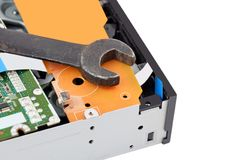 Dvd disk drive and wrench. Detailed view of the inside of dvd disk drive and wrench Stock Photo