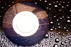 DVD disk with droplets. CD DVD disk with some droplets Stock Photo