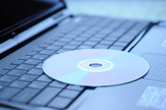 DVD disk and laptop Royalty Free Stock Images