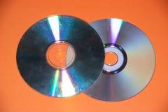 Dvd disk on an orange background. CD stock photo