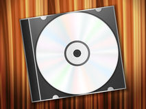 Dvd disk on wooden desk Royalty Free Stock Images