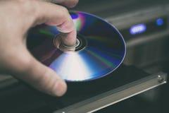 DVD-Diskette in der Hand Lizenzfreies Stockbild