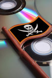 Dvd disks with flag pirate skull Stock Photography