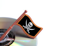 Dvd disks with flag pirate skull. Isolated on white royalty free stock photography