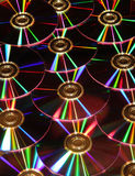 DVD disks reflections. DVD disks in the dark reflecting show lights Royalty Free Stock Image