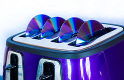 DVD Disks Toaster Stock Image