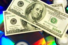 DVD en geld. Royalty-vrije Stock Foto's