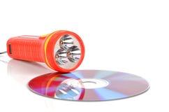 DVD and flashlight Stock Photo
