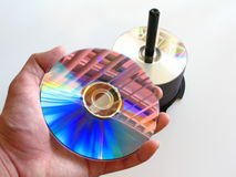 DVD in hand reflecting light royalty free stock photo