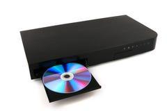 DVD, inserzione del disco del CD al lettore DVD su fondo bianco, primo piano, isolato Fotografia Stock