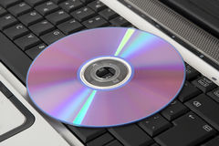 Dvd on laptop Stock Photography
