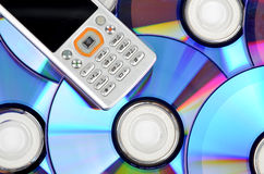 DVD and mobile phone Stock Images