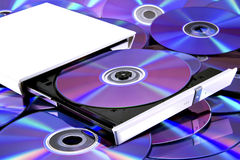 DVD multi recorder & cd's. Portable dvd drive with a dvd disc inside on discs royalty free stock image