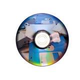 Dvd oder CD und alte Diskette nach innen Stockbilder