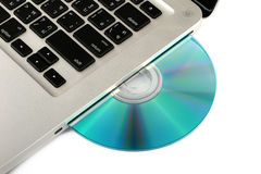 DVD ottico, unità CD sul computer portatile su fondo bianco, primo piano, isolato Fotografia Stock Libera da Diritti