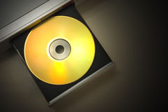 Dvd player. With open tray with a gold disk with dramatic light stock photography