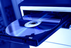 DVD Player. Open with DVD on tray - in blue light Stock Image