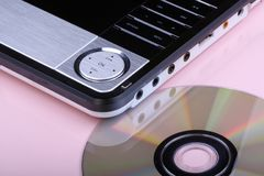 DVD player and disc. Portable DVD player and disc on pink Stock Image