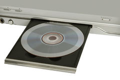 DVD player with inserted disc taken closeup on white. DVD player with inserted disc taken closeup on white background Royalty Free Stock Photos