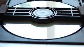 DVD player. Inside a DVD player. Download and extract the DVD disc from the player. DVD disk stock video footage