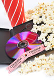 DVD, popcorn, soda and cinema tickets. DVD, popcorn with soda and two cinema tickets on white background Royalty Free Stock Images