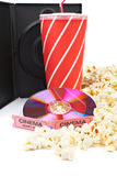 DVD, popcorn, soda, tickets. DVD, popcorn with soda and two cinema tickets on white background Royalty Free Stock Photography