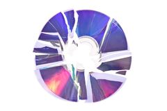 DVD quebrado/CD isolado no branco Fotografia de Stock Royalty Free
