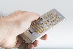 DVD Remote Contro. A left male hand holding DVD remote stock photo