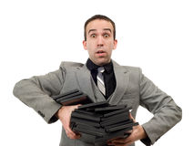 DVD Rentals. A man wearing a suit carrying an armful of dvd cases, isolated against a white background Stock Photography