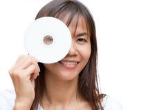 dvd rom微笑妇女 库存照片